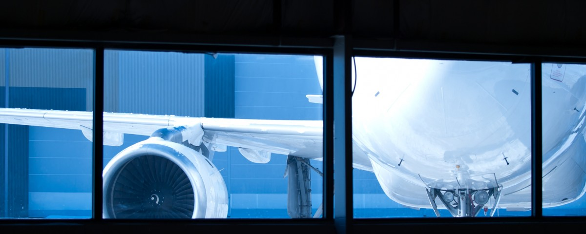 Aircraft wainting for maintenance outside the hangar window